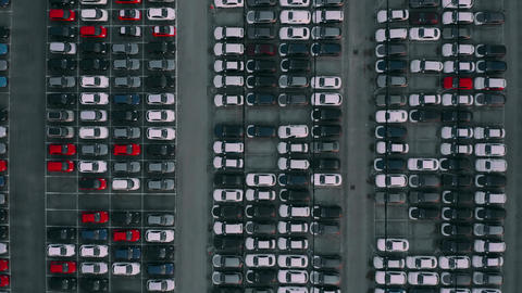 Aerial top down shot of a car factory new cars storage Footage
