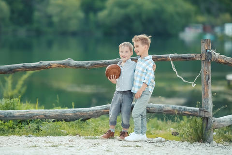 boys playing in the banks of the pond Photo