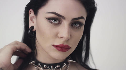 Cute woman with sexy lips, big blue eyes, long black hair is looking at camera Live Action