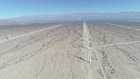 Aerial drone scene of wind field full of aligned wind turbines in Aimogasta, la rioja, Argentina. Footage