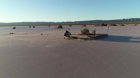 Aerial drone scene of lonly laying down sail car at desertic plane track. Plane desert ideal for Live Action