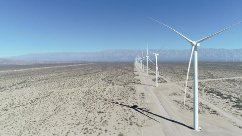 Aerial drone scene of wind field full of aligned wind turbines in Aimogasta, la rioja, Argentina. Live Action