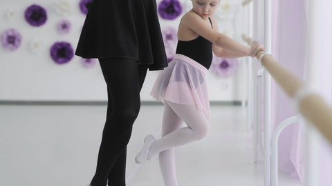 Small ballerina repeats the movements with the teacher. ballet lesson in the Footage
