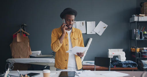 Creative designer making telephone call with smartphone talking at work Footage