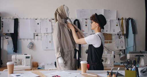Fashion designer dressing mannequin checking handmade gadment working alone Footage