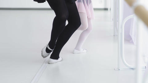 Little ballet dancer repeats the movements with the teacher Footage