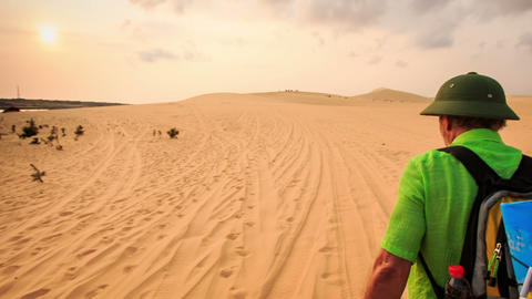 Tourist Walks along Sand Tracks in White Dunes to Horizon Footage