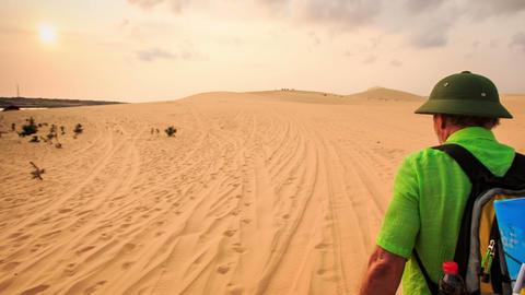 Tourist Walks along Sand Tracks in White Dunes to Horizon Footage