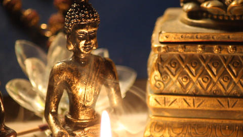 Buddha statue with candle burning and incense 14 Footage