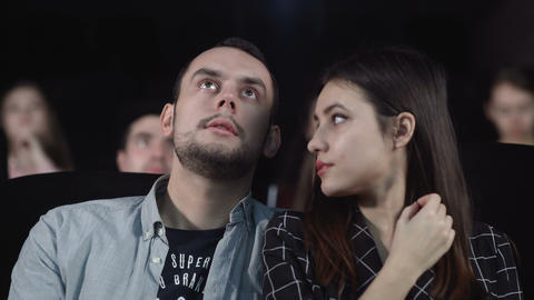 Smiling woman watching movie. Romantic couple watch comedy film Live Action
