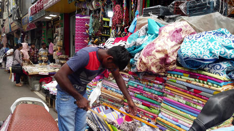 Colombo, Sri Lanka - 2019-03-21 - Street Cloth Vendor Cleans Inventory Footage