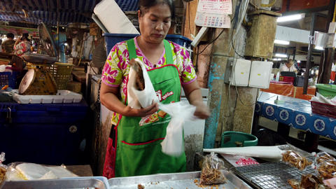 Lampang, Thailand - 2019-03-07 - Market Vendor Makes a Sale Footage