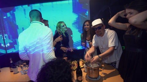 Hip hop man tries to joggle ice at night club party and fails Footage