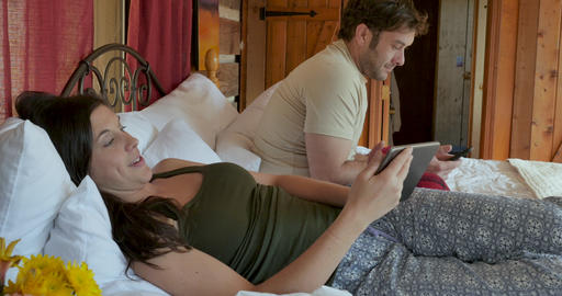Young handsome man putting down his mobile phone and paying attention to a beautiful woman with a Live Action