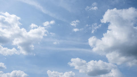 Rolling puffy clouds in a blue sky, cloudscape time-lapse, peaceful and tranquil Live Action