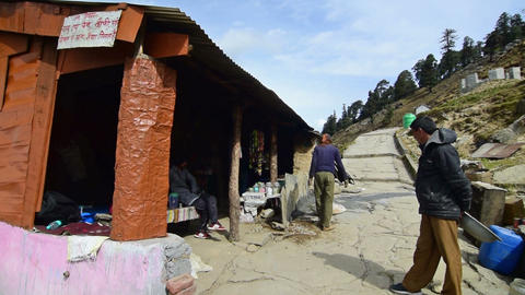 People building structure on trekking route to Tunganath Temple Footage