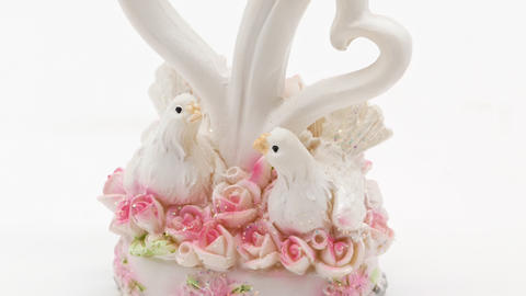 Two white pigeons statuette on white background Live Action