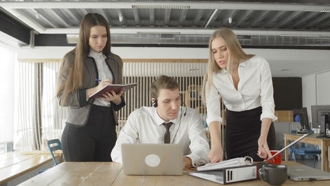 Attractive female managers are talking to their subordinate. One woman point to Live Action