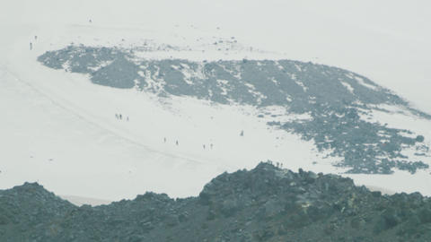 People mountaineer tourists walking on hight snowy mountain slope Live Action