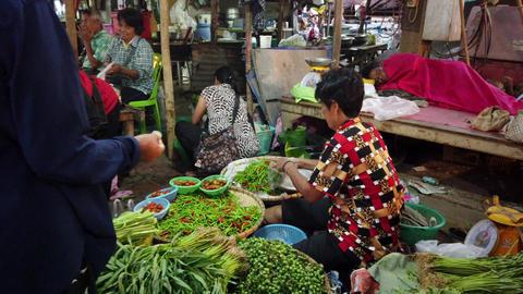 Sukhothai, Thailand - 2019-03-06 - Vegetable Vendor Makes Sale At Outdoor Market Footage