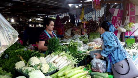 Sukhothai, Thailand - 2019-03-06 - Vegetable Market Vendor Makes Sale Footage