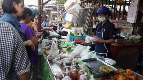 Sukhothai, Thailand - 2019-03-06 - Woman Street Vendor With Mask Sells Lunch to Live Action