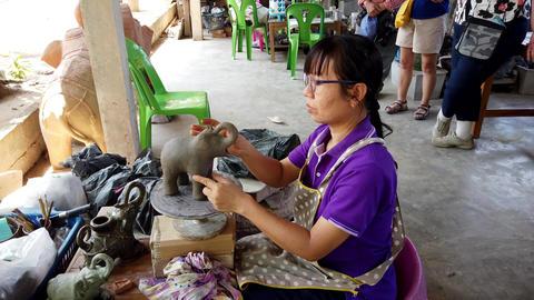 Sukhothai, Thailand - 2019-03-06 - Sculptor Puts Ears On Clay Elephant Footage