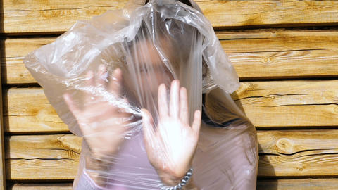 Woman try to get out the plastic bag Live Action