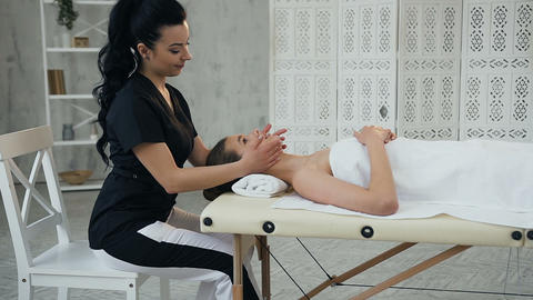Beautiful caucasian woman during relaxing massage on the face in the massage Live Action