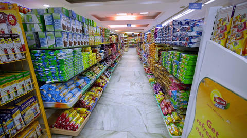 Many cookies and candies on the shelf in the supermarket. snacks on a grocery store display. Many Footage