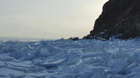 Great view of the scenery of freeze surface of the iced stones of the reservoir Footage