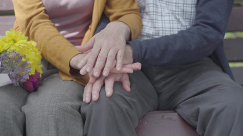 Close up hands of mature people. Hands of an old woman holding the hand of old Live Action