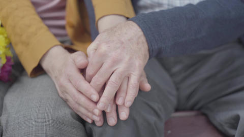 Hands of an old woman holding the hand of old man. Hands of mature people close Live Action
