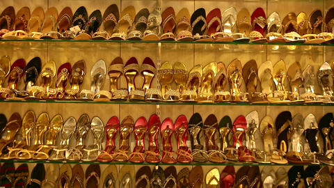 Classic women's shoes in different colors. Black, red, yellow, pink, gold shoes with a heel on the Footage