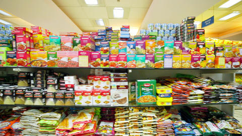 Many cookies and candies on the shelf in the supermarket. Interior shot of city supermarket Live Action