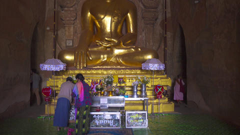 People pray before statue of Buddha in pagoda Footage