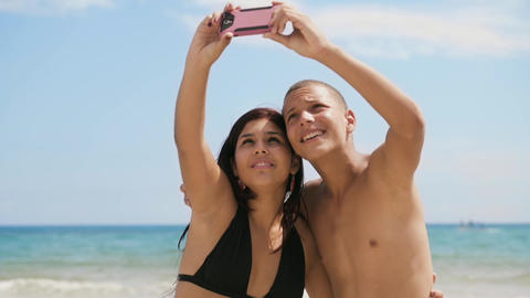 1-Teenagers Girl And Boy Taking Selfie With Phone On Beach Footage