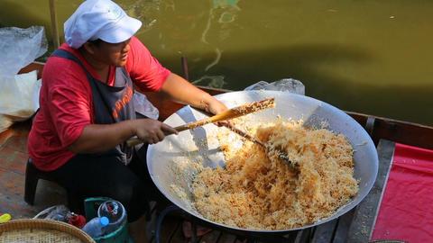 Cuisine on boat - floating market in Bangkok Live Action