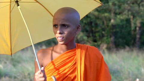 Haberna, Sri Lanka- 2019-03-22 - Closeup of Young Monk With Yellow Umbrella Footage