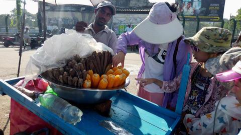 Nogombo, Sri Lanka- 2019-03-22 - Family Chooses Ears of Sweet Corn From Vendor Footage