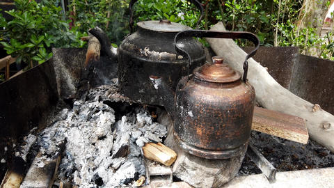 Open Fire Heats Water To Make Tea Footage