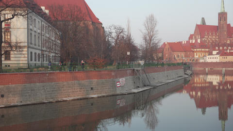 Pan from promenade to old architecture on Ostrow Tumski in Poland Footage