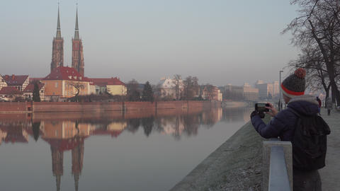 Young person takes picture of Cathedral Island in Wroclaw Footage