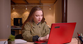 Portrait of young teenage girl working with laptop achieves the success gets Footage