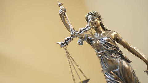 Statue of Justice on Yellow Background Footage