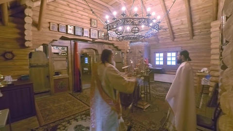 Christian divine service in an orthodox wooden Russian church Footage
