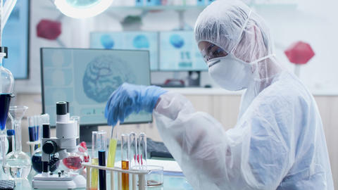 Scientist in white coverall and protective glasses... Stock Video Footage