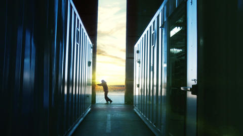Man Opening Door Of A Container Warehouse At Dusk Live Action