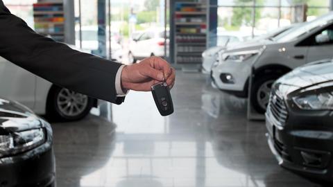 Salesman dealer hold a car keys Footage