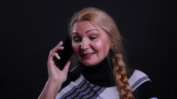 Closeup portrait of middle-aged caucasian female having a phone call with Footage